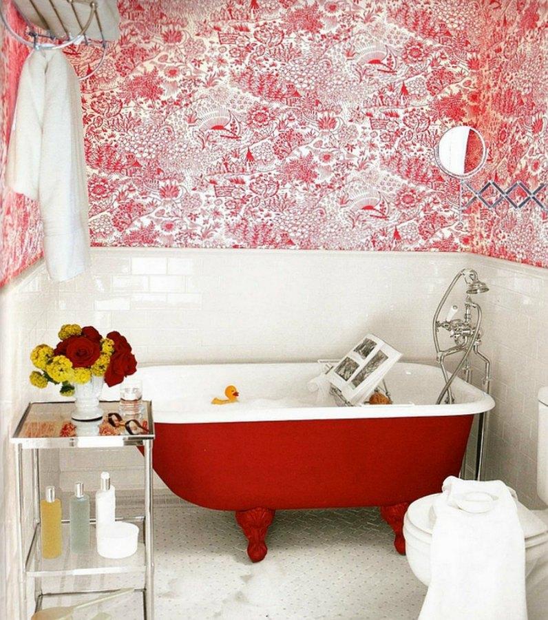 red metal clawfoot bath tub
