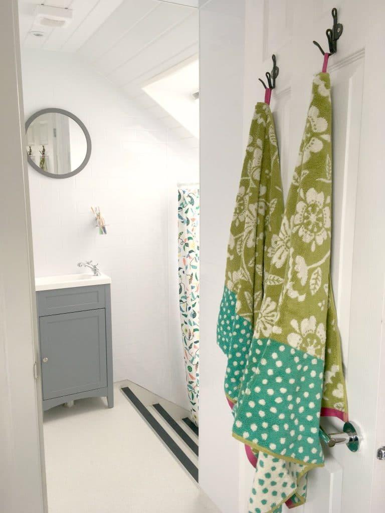 gudrun sjoden green organic towels hanging in white bathroom