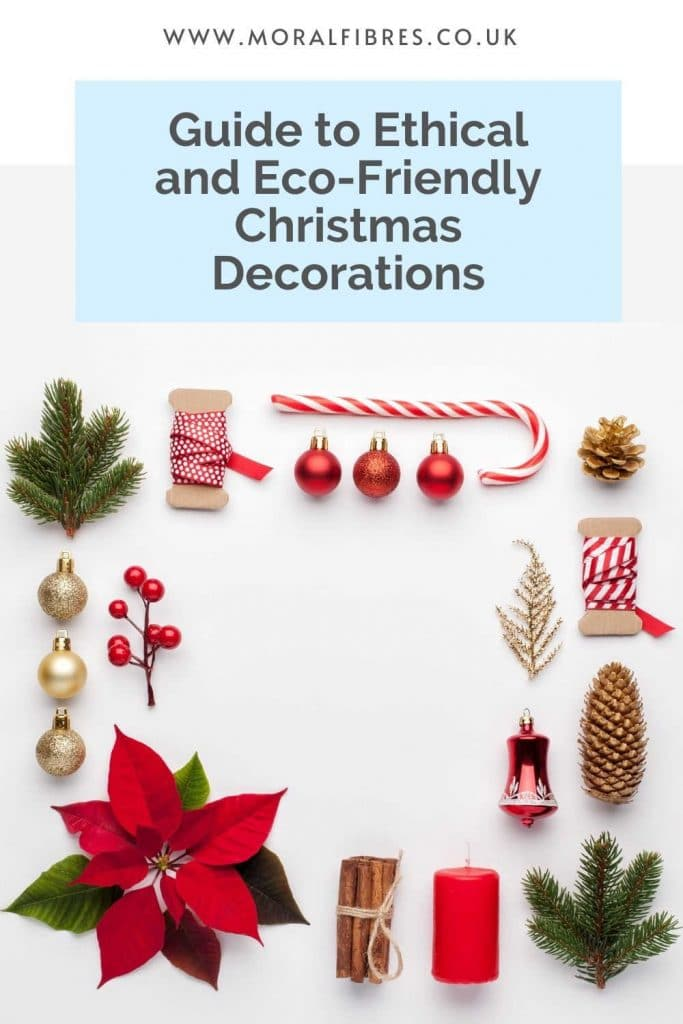 A flat lay of Christmas decorations on white background with a blue text box that says guide to ethical and eco-friendly Christmas decorations.