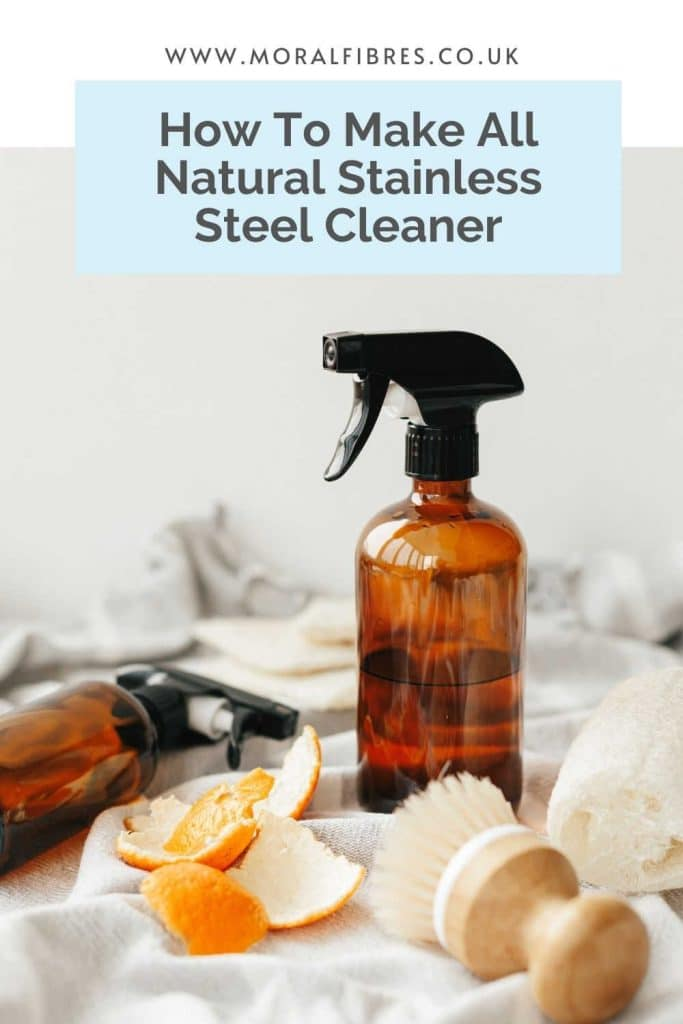 Image of a brown amber spray bottle with a blue text box that says how to make all natural stainless steel cleaner