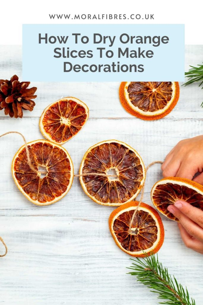 Image of a dried orange Christmas garland with a blue text box that says how to dry orange slices to make decorations