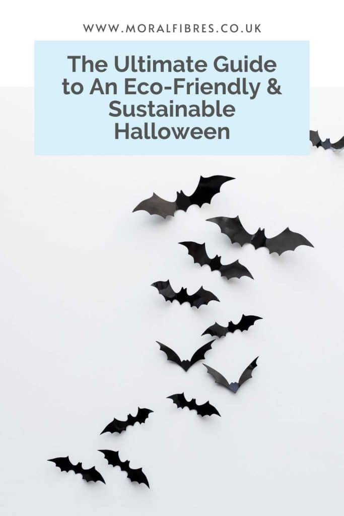 Image of black paper bats with a blue text box that says the ultimate guide to an eco-friendly and sustainable halloween