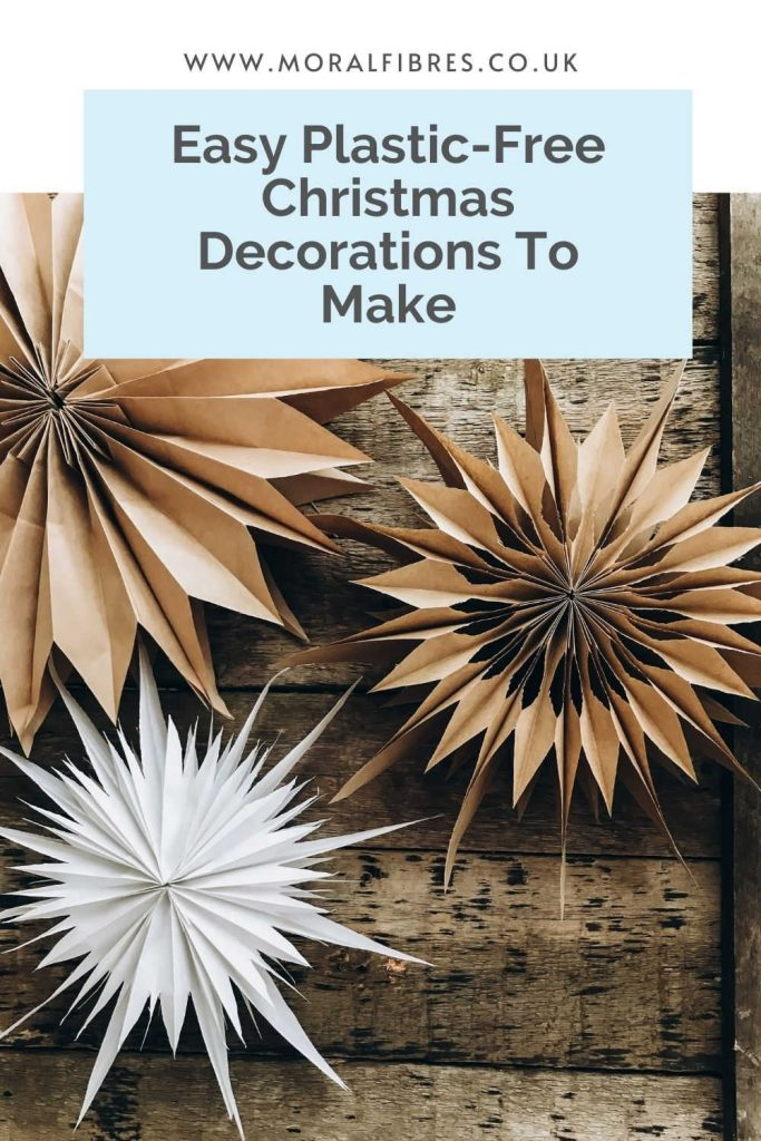Image of paper bag stars with a blue text box that says easy plastic-free Christmas decorations to make